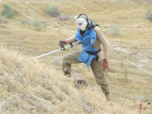 Deminer working in M55, the largest recorded minefield in Tajikistan.